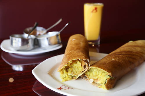 Masala dosa and mango lassi drink   [EVE EDELHEIT  |  Times]