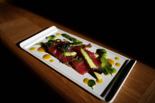 Tuna crudo with sorrel, spring vegetables, harissa, saffron vinaigrette  [OCTAVIO JONES  |  Times]