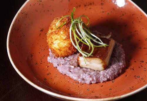 The crispy maple-cured pork belly  [LARA CERRI  |   Times]