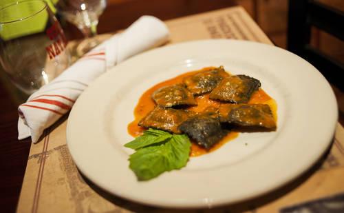 Black squid ravioli with tomato basil sauce  [OCTAVIO JONES  |  Times]