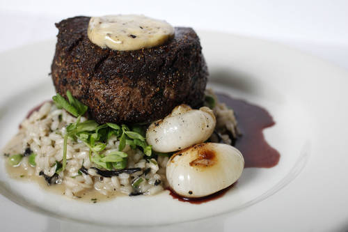 Peppercorn-crusted filet mignon  [EVE EDELHEIT  |  Times]