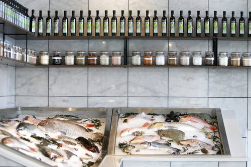 A display of fresh fish visible at the entrance  [EVE EDELHEIT  |  Times]