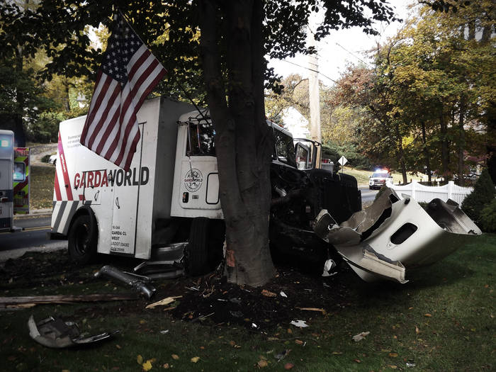 A Garda armored truck crashed head-on into a tree.