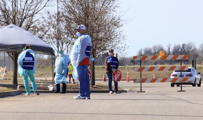 Pictured here, workers with the Oklahoma State Department of Health prepare to administer coronavirus tests at a drive-up testing clinic in Ponca City March 25. (Photo by Jordan Green/Journal-Tribune)