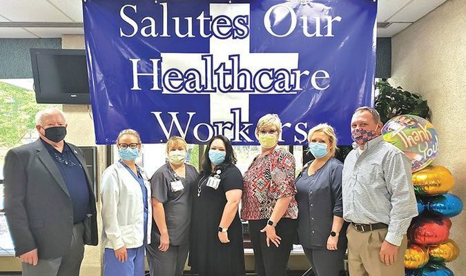 Big Stone Gap Mayor Gary Johnson, left, and Town Manager Stephen Lawson, right, stand with Lonesome Pine Hospital staff at a reception to honor healthcare workers and support staff.  TERRAN YOUNG PHOTO