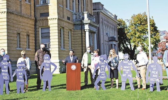 Local officials recognized Domestic Violence Awareness Month with an event last week on the county courthouse lawn in Wise. The event included Commonwealth Attorney Chuck Slemp, Sheriff Grant Kilgore, victim-witness coordinator Sandi Brewer and representatives of Family Crisis Support Services. Lifelike silhouettes representing domestic violence victims were placed on the lawn.  JESSICA HOOD PHOTO