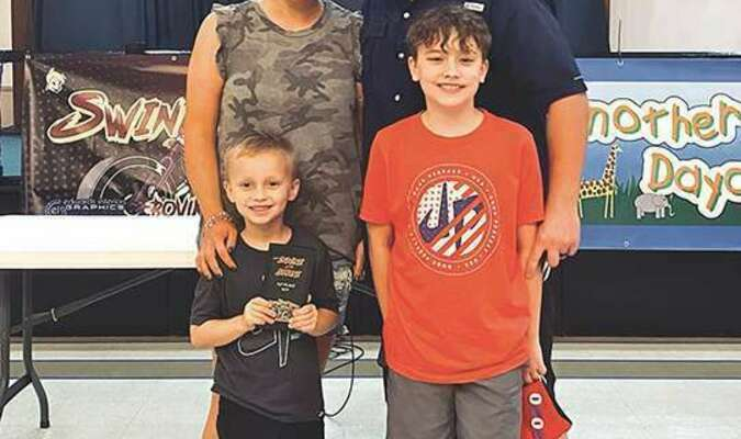 Bullock's Low and Slow won first place at Bovine at the Shrine in Savannah, Ga. Pictured are Jillian, Brett, Tucker and Cooper.   PROVIDED BY THE BULLOCK FAMILY