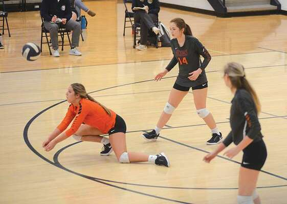 Gracie Gibson lays it out to get under this serve Tuesday. PHOTO BY KELLEY PEARSON