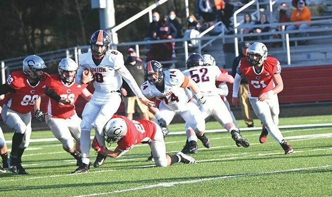 Union's Bradley Bunch breaks a tackle on his way to the first score of the day. RICHARD MEADE PHOTO