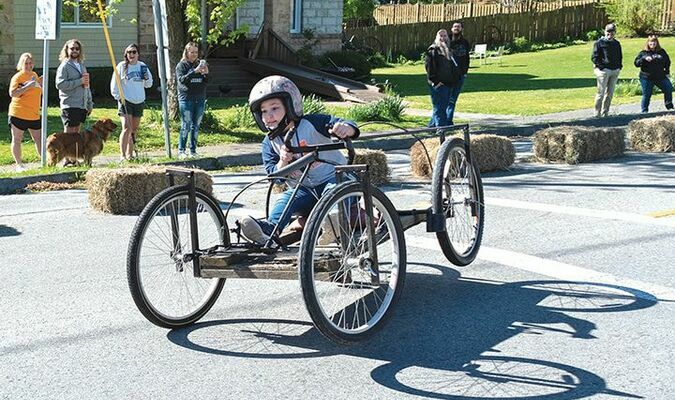 Jillian Falcone gets air between two wheels and the pavement Saturday during the third annual Lonesome Pine Soapbox Derby. She was able to keep it under control. KED MEADE PHOTO