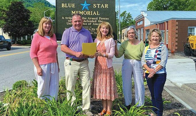 Big Stone Gap Mayor Gary Johnson has issued a proclamation designating June 6-12 as National Garden Week. Garden Club members pose for a photo receiving the proclamation. Left to right are Paxton Allgyer, Town Manager Stephen Lawson, Ruth Ann Price, Betty Fleenor and Andrea Meador.   GARY HARRIS PHOTO