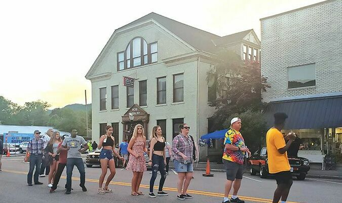 Dancers take over Big Stone Gap's Wood Avenue June 4 during a townwide birthday celebration for Freedom Chevrolet's Jordan Clark Barnette, who passed away in January. The event helped raise funds for Wise County special needs classrooms.  TERRAN YOUNG PHOTO