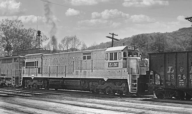 I must have heard L&N train 855 blowing for the road crossing in the west end of town. Appalachia, VA was my hometown then. I walked over to the Pine Street crossing (our family residence was an apartment on Main Street, so train watching was quite convenient) to see what was up front. The SDP35 on the point wasn't all that unusual, but new U30C 1539 was. Without much thought, I snapped a back-lit shot as the engineer started throttling up for the 10-mile climb to Norton, VA. While this was a new model for the L&N, Southern's five U30Cs had been on the parallel main in the foreground the previous July—so the 1539 was not the first of that model in Appalachia.