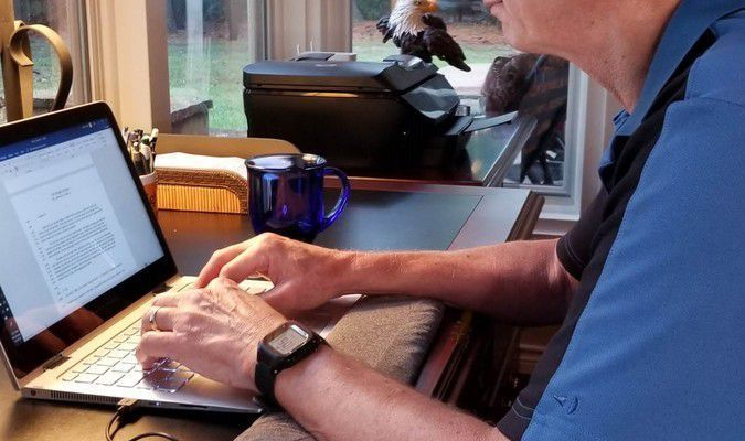 Aaron Zook, author, at work on his next youth mystery novel.