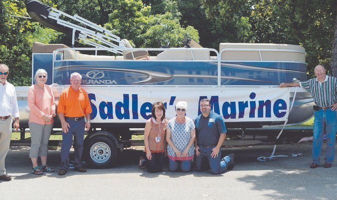 The Rusk State Hospital Volunteer Council presented RSH with a new pontoon boat from Sadler's Marine of Jacksonville for the enjoyment of patients. Pictured in no particular order are Pat Richey, Paula Little, RSH superintendent Brenda Slaton, Jeannie Whitaker, Davlin King, Ben Middlebrooks, Jesse Whitaker and Robert Sadler of Sadler's Marine.