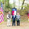 A small group of Cherokee County Historical Commission (CCHC) members met December 15 on the side of U.S. Highway 69 to formally dedicate the Texas State Historical marker for the Sheriff Bill Brunt murder site. Cherokee County Sheriff James Campbell and County Judge Chris Davis joined CCHC member Jim Cromwell prior to the unveiling. Later, about 40 attendees gathered for a reception and program at the CCHC office. Mr. Cromwell spoke and Judge Davis and Sheriff Campbell shared stories as well.  Also in attendance was Mr. and Mrs. Hal Brunt attended. Hal is the son of Frank Brunt.