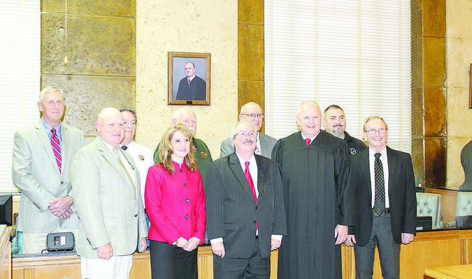 Cherokee County's elected officials took their oaths of office during a ceremony held New Year's Day at the Cherokee County Courthouse. In front from left are Precinct 1 Commissioner Kelly Traylor, County Attorney Dana Young, 2nd Judicial District Attorney Elmer Beckworth, 2nd Judicial District Judge Chris Day and Precinct 2 Constable Jack White. In back are Precinct 3 Commissioner Patrick Reagan, Precinct 1 Constable Lynn Kelley, Precinct 3 Constable Eddie Lee, Cherokee County Sheriff James Campbell and Precinct 4 Constable Jamie Beene. Not pictured is Tax Assessor-Collector Linda Little.