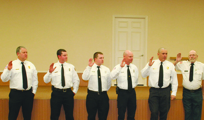 Rusk Mayor Angela Raiborn (right) swore in the Rusk Volunteer Fire Department's officers during their annual banquet, held Monday night at the Rusk Civic Center. From left are Bob Goldsberry (chaplain), Rusk VFD Chief Donald Lankford, Kody Killion (fire marshal), Jonathan Phillips (reporter), Terry Phillips (2nd assistant chief, secretary/assistant fire marshal), James Sanchez (assistant chief), Don Vandever (treasurer) and Mayor Raiborn.