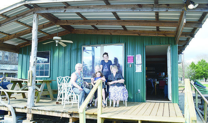 Bertha Daniel (left) is the owner of Bertha's Cafe in Maydelle, which reopened in October of 2016 after fire destroyed the previous place of business.  Sisters Bonnie Dosser (middle) and Velma Minchew (right) lend a hand, with a little help from Bonnie's granddaughter Cheyenne Fairchild (back) and Velma's great-great granddaughter Renee Hinson, age 5 (front).