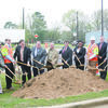 Several TxDOT and Cherokee County dignitaries move the first dirt on the U.S. Highway 69 widening project through Wells during a ceremony Monday morning. The project has been approximately 30 years in the making and will widen the existing roadway to a four-lane divided curb and gutter section. From left are Jacksonville Chamber of Commerce chair Andy Calcote, Precinct 1 Commissioner Kelly Traylor, TxDOT Tyler Area Engineer Shane Cunningham, East Texas Council of Governments Executive Director David Cleveland, Cherokee County Judge Chris Davis, Wells Mayor C.W. Williams, Texas Transportation Commissioner Jeff Austin III, USDA Rural Development Area Director Yolanda Collins, TxDOT Tyler Deputy District Engineer Vernon Webb, Jacksonville Chamber Economic Development Chair Nathan Jones, Precinct 2 Commissioner Steven Norton and Precinct 4 Commissioner Byron Underwood.
