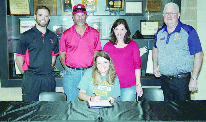 Photo: Quinten Boyd Rusk golfer Lily Raiborn signed her letter of intent to play golf at Jacksonville College. She is pictured with (back row, from left), Rusk golf coach Joey Renner, father Mark Raiborn, mother Angela Raiborn and Jacksonville College golf coach Dr. Roy Stephens. For more, see pg. 4B.