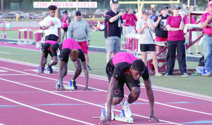 "Photo: Tara Hood  Rusk's Ladadrian Polk (front), Semaj Johnson (middle) and Anthony ""NuNu"" Hunter (back) prepare to take off at the start of the 400 meter dash at the annual Doug Jordan Relays. For results and pictures, see pgs. 1B and 4-5B."