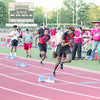"""Semaj Johnson (front) and Anthony """"NuNu"""" Hunter take off at the start of the 400 meters. Johnson finished fourth in the event. Both Johnson and Hunter were part of the 4x400 relay team; Johnson also ran with the 4x100 team."""