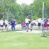 Rusk's Jermaine Lewis finishes a toss in the discus event during the District 16-4A Track Meet, held April 13-14 at Carthage High School. Lewis advanced to area after finishing fourth in the event. He is one of 11 Rusk athletes and 115 athletes countywide to advance to the area track meets.