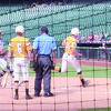 Photo: Beverly Milner  Alto's Harmon West crosses home plate while teammate Cameron Cox looks on during the Jackets' game against Garrison at Minute Maid Park – the home of the Houston Astros. In the showcase game, the Jackets fell just short to the Bulldogs, 8-7.