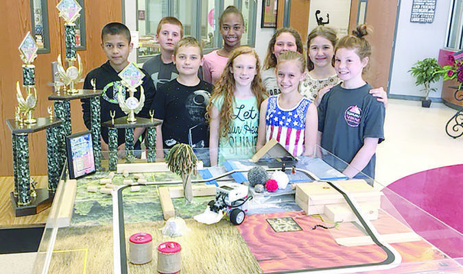 The Rusk Intermediate School robotics teams, part of Dianne Guthrie's Gifted/Talented class, brought home three top-3 trophies from the recent Region VII Robotics contest in Kilgore. From left are Anthony Rojo, Matthew Young, Landon Walley, Kierra Milton, Kaitlyn Hardy, Katie Ross, Nicole Burkhalter, Maci Taylor and Gracie Knight. Not pictured is Alex Patterson.