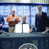 Sen. Robert Nichols (second from left) applauds as Gov. Greg Abbott signs Senate Bill 16, which lowered license to carry and renewal fees in Texas, making it one of the lowest fees in the nation. Sen. NIchols was recently named President Pro Tempore of the Texas Senate, making him acting governor if both the governor and lieutenant governor are out of the state at the same time.