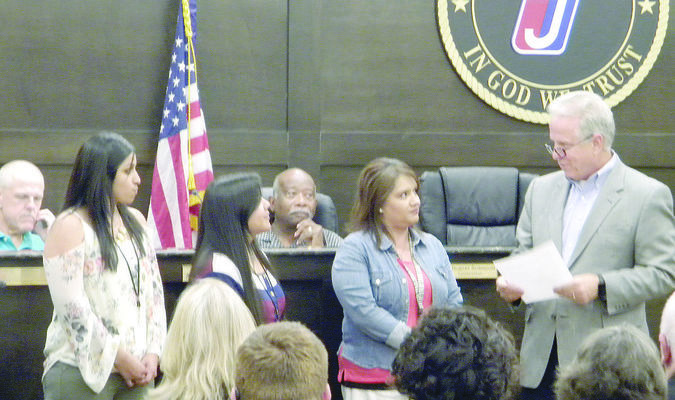 Mayor Stone recognizes Jacksonville Municipal Court employees Margarita Meza, Susana Galvan and Silvia Telles as employees of the month for May during the monthly city council meeting June 13.