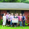 The Rusk Area Garden Club has chosen the yard of Josh and Briana Gentry at 115 Short Street as its June Yard of The Month. Pictured are Linn Landis, Martha Neeley, Judy Waugh, Elizabeth Holcomb, Briana Gentry, Sissy Crysup, Maxine Pierce and Jane Parsons.