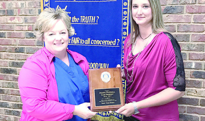 Rusk Rotary Club incoming president Bridgett Tosh presents outgoing president Jaleea Hudnall with a plaque of appreciation for all of her hard work as president during the 2016-2017 year. The Rusk Rotary Club would like to thank Ms. Hudnall for her hard work and service.
