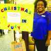 Jacksonville Library Director Trina Stidman shows off the Christmas in July kiosk at the Jacksonville Library, which benefits the county' abused or neglected children.