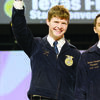 Alto native and former Texas FFA officer Creager Davis salutes the crowd during the 89th annual Texas FFA State Convention, held July 10-14 in Corpus Christi. Davis recently finished his term as state vice-president with the Texas FFA.