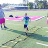 Courtesy Photo: Brittany Welch  Tristen Welch runs a drill during the annual Rusk Football Camp July 17-18. Drills throughout the camp focused on footwork, agility, hand-eye coordination and other basics. Coach Jowell Hancock said the camp had a solid attendance.