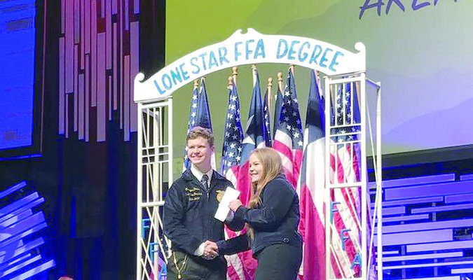 Savannah Applewhite received her Lone Star Chapter degree, which is the highest degree awarded to members in the state for commitment and service to the FFA organization. She is pictured with outgoing Texas FFA officer and Alto native Creager Davis.