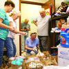 From left, Cherokee County Child & Family Service Board President Nancy Washburn, board member Shirley Reese and drive organizers Diki and Jerry Parker get a peek at some of the many donated items collected during last month's Christmas in July donation drive, to help stock the county's Rainbow Room. Donations were delivered to the Rainbow Room on Aug. 9. Also pictured is Reese's husband, Jim, who documented the delivery for the Rainbow Room.