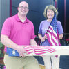 "On Monday, Sept. 11, C. Chase Hobson, representative of WoodmenLife (formerly Woodmen of the World) presented an American flag to Carlene Clayton, Rusk Intermediate School principal during what the school themed ""Red, White and Blue Day."" A total of 25 U.S. flags were given in memory of those who perished during the 9-11 attacks in 2001."