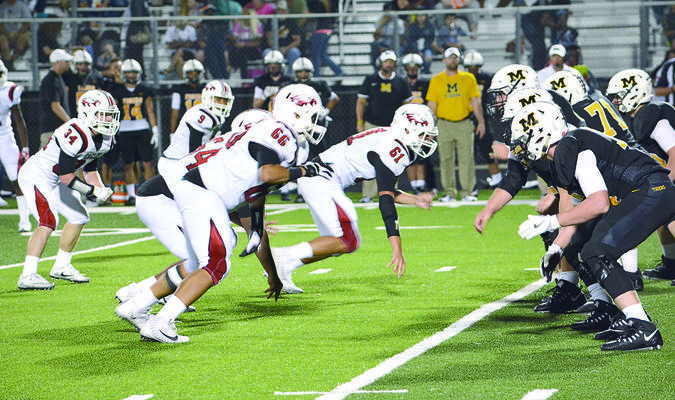Photo: Jason Crysup The Rusk Eagle defense fires off the line of scrimmage during their game Friday at Malakoff. From left for Rusk are NuNu Hunter (#11), Bryce Wimer (#34), Caleb McNair (#9), Jermaine Lewis (#64), Zayden Devereaux (#66) and Jace Rogers (#61). The Eagles lost a tight game to the Tigers, 29-27. Rusk (1-1) will return home to take on Crockett (1-1) at 7:30 p.m. Friday at Jim Swink Field at Eagle Stadium. The game can be heard on KTLU 1580 AM and online at thecube.com/event/rusk-eagles-vs-crockett-bulldogs-boys-varsity-foot-746311.