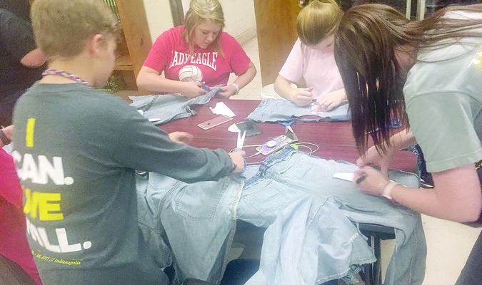 "The Rusk FFA served the Cherokee County community with their annual ""Week of Service,"" held Sept. 25-29. Above, members cut blue jeans to create shoes for Sole Hope, which is a program that sends shoes to Uganda to protect against the Chigoe flea."