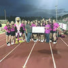 The Rusk High School cheerleaders presented American Cancer Society and Relay for Life of Cherokee County volunteer Jamie King and community development manager Kim Herman with a check for $1,000 during Rusk's annual pink-out game Oct. 20 against Huntington.
