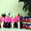 "East Texas Medical Center Jacksonville ""Pink Ladies"" stand in front of gift bags full of hats they have handmade to donate to local charities. They make about 900 hats each year to donate."