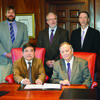 Pictured, Dr. Zhang Jianqiu, president of the Jilin Provincial Academy of Forestry Sciences, seated left, signs the cooperative agreement with Dr. Baker Pattillo, president of SFA. Standing from left are Dr. Matthew McBroom, associate dean of SFA's Arthur Temple College of Forestry and Agriculture; Dr. Hans Williams, dean of the college; and Dr. Steve Bullard, provost and vice president for academic affairs at SFA.
