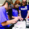 Students conduct an experiment simulating how chemists determine toxicity while Paul Rogers, Stephen F. Austin State University junior computer science major from Wells, assists.