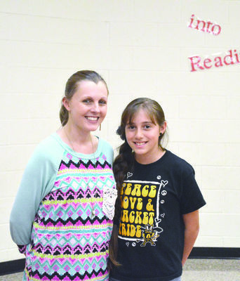 Alto Elementary student Angelina Lindsey, a 10-year-old fourth grader, placed first with her entry in the conservation poster contest sponsored by the Cherokee County Soil & Water Conservation District. She is pictured with teacher Amanda Low.