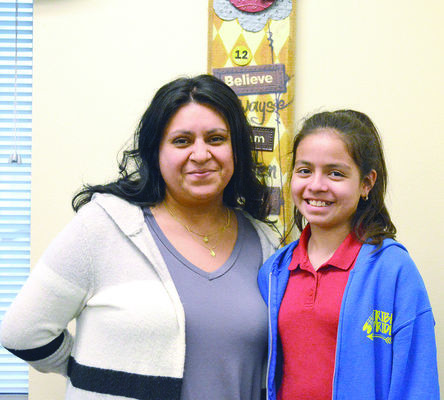 Placing second in the 2018 conservation poster contest was Dafne Lara, age 10, a fourth grader at Joe Wright Elementary in Jacksonville. She is pictured with teacher Maria Galvan.