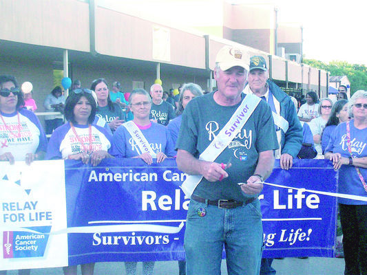 Longtime Relay volunteer and cancer survivor Jay Hooker cuts the ribbon, officially kicking off the 20th annual Cherokee County Relay for Life event on Friday, April 27.