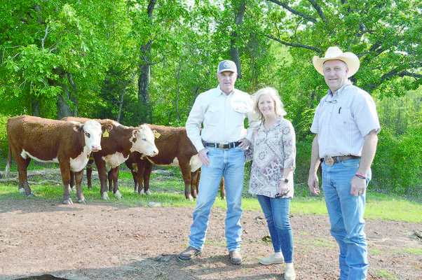 Bryan and Sarah Selden (left) will be recognized by Preston Lindsey (right), director of zone 1 of the Cherokee County Soil & Water Conservation District, for Land Reclamation and Cattle Production at the annual awards banquet May 4 in Jacksonville.